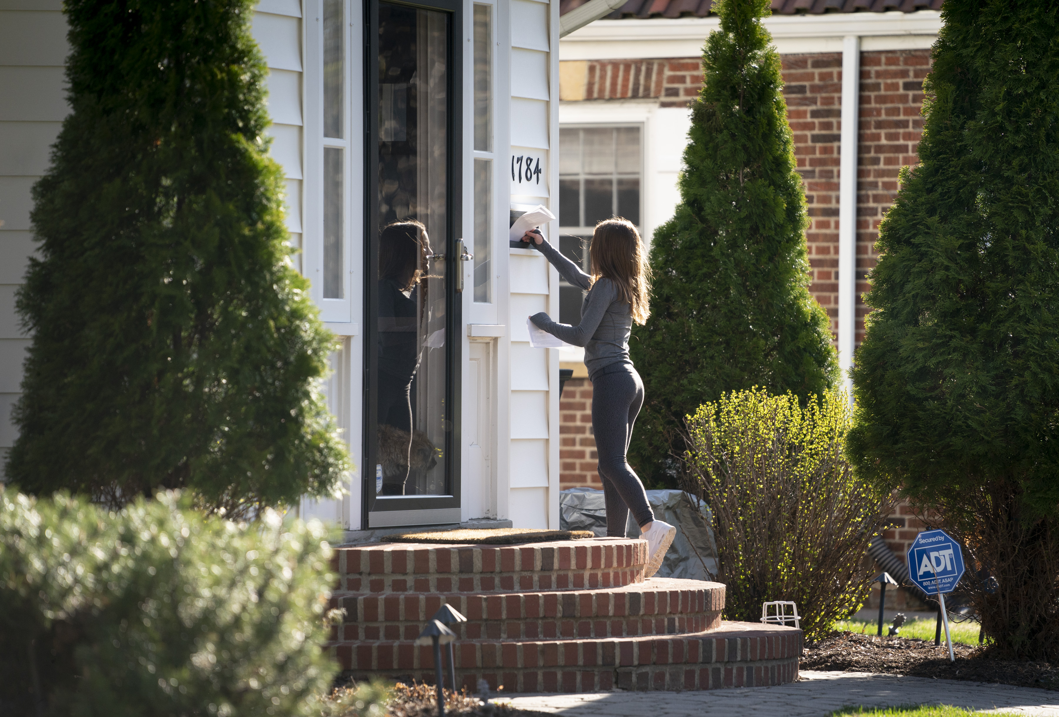 Maddie Pierce, 13, delivered the daily newspaper she and her sister and two neighbor siblings make for their neighborhood.