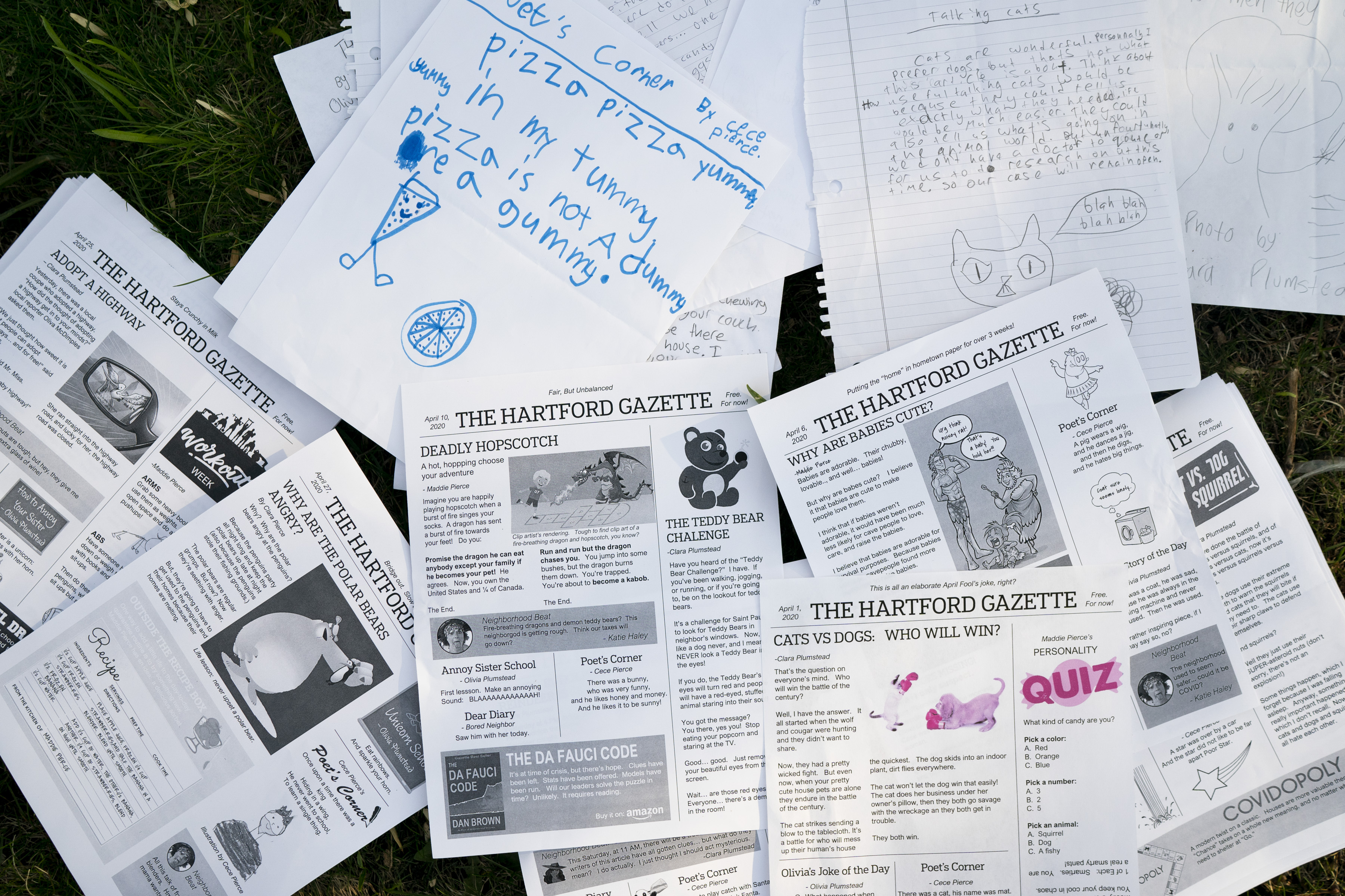 Sisters Cece, 7, and Maddie Pierce, 13, and sisters Clara, 10, and Olivia Plumstead start by writing each section by hand and their neighbor (Sean Haley who works at the Star Tribune) lays it out in a newspaper style.