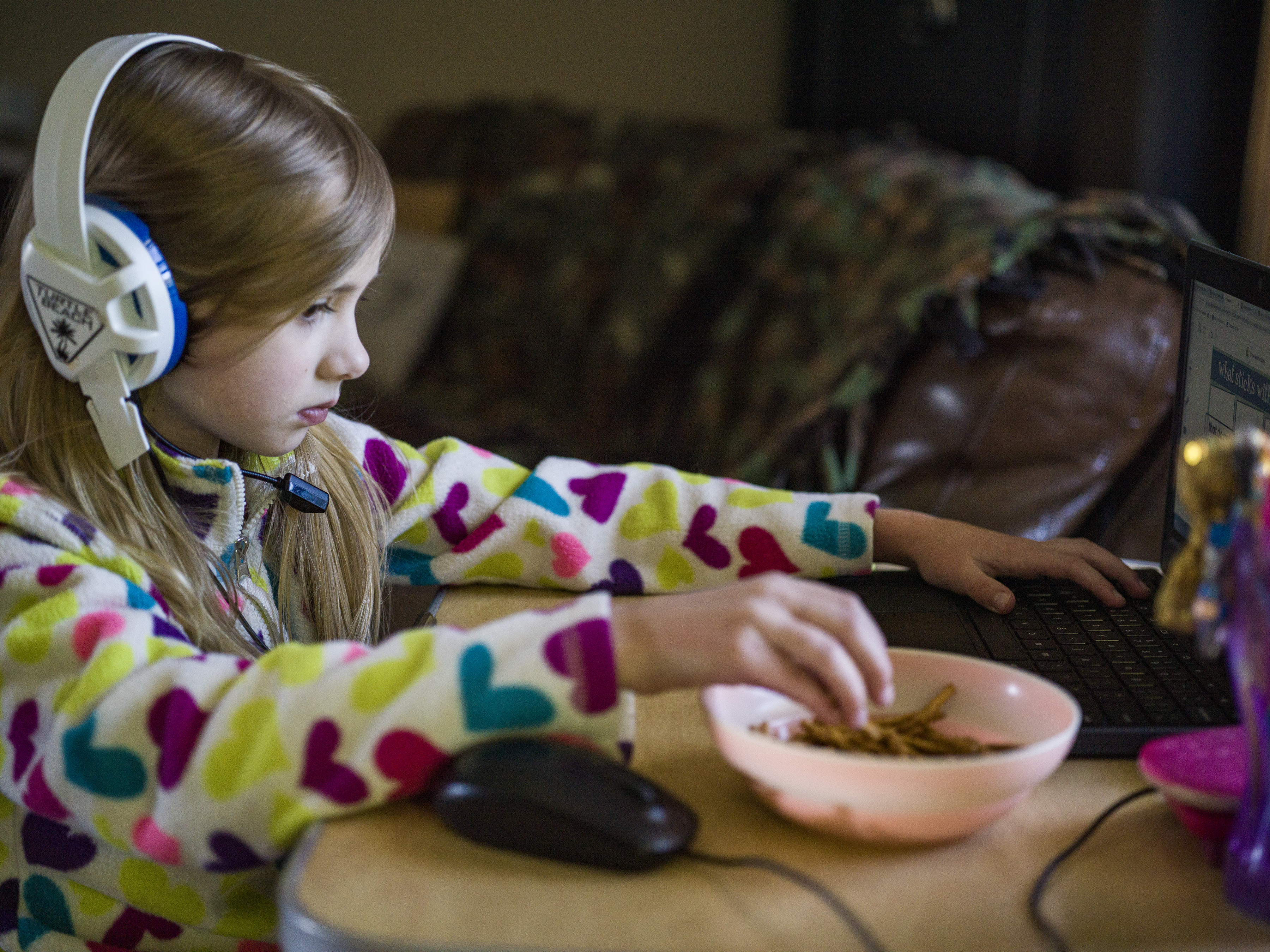 In Owatonna, MN on May 12, 2021, Abigail Hadt, 7, does some online schoolwork.