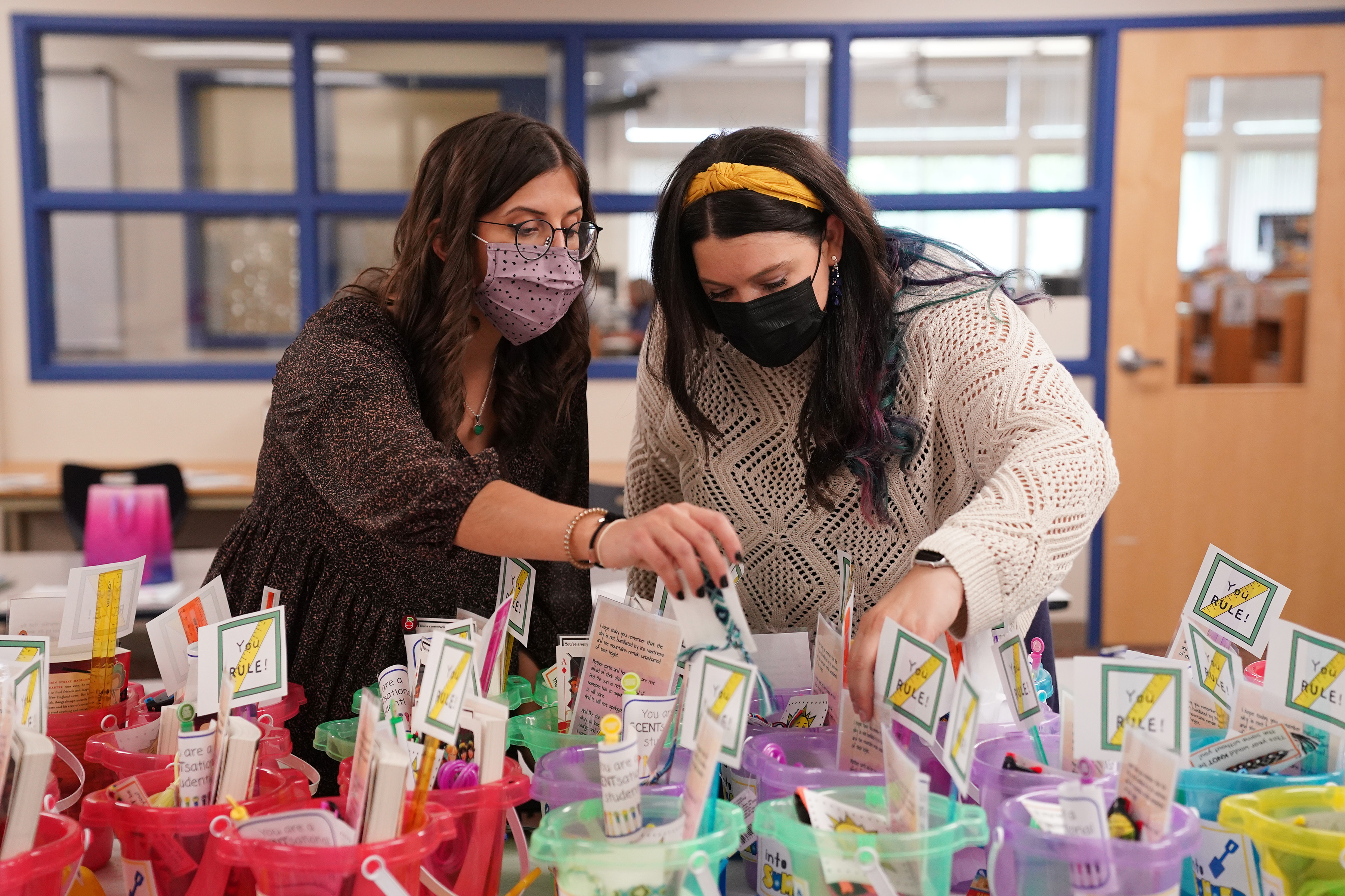 Emilee Vlasin, left, and Emily Wahlquist, both third grade teachers at Washburn Elementary, packed up end of the year gifts for their students.