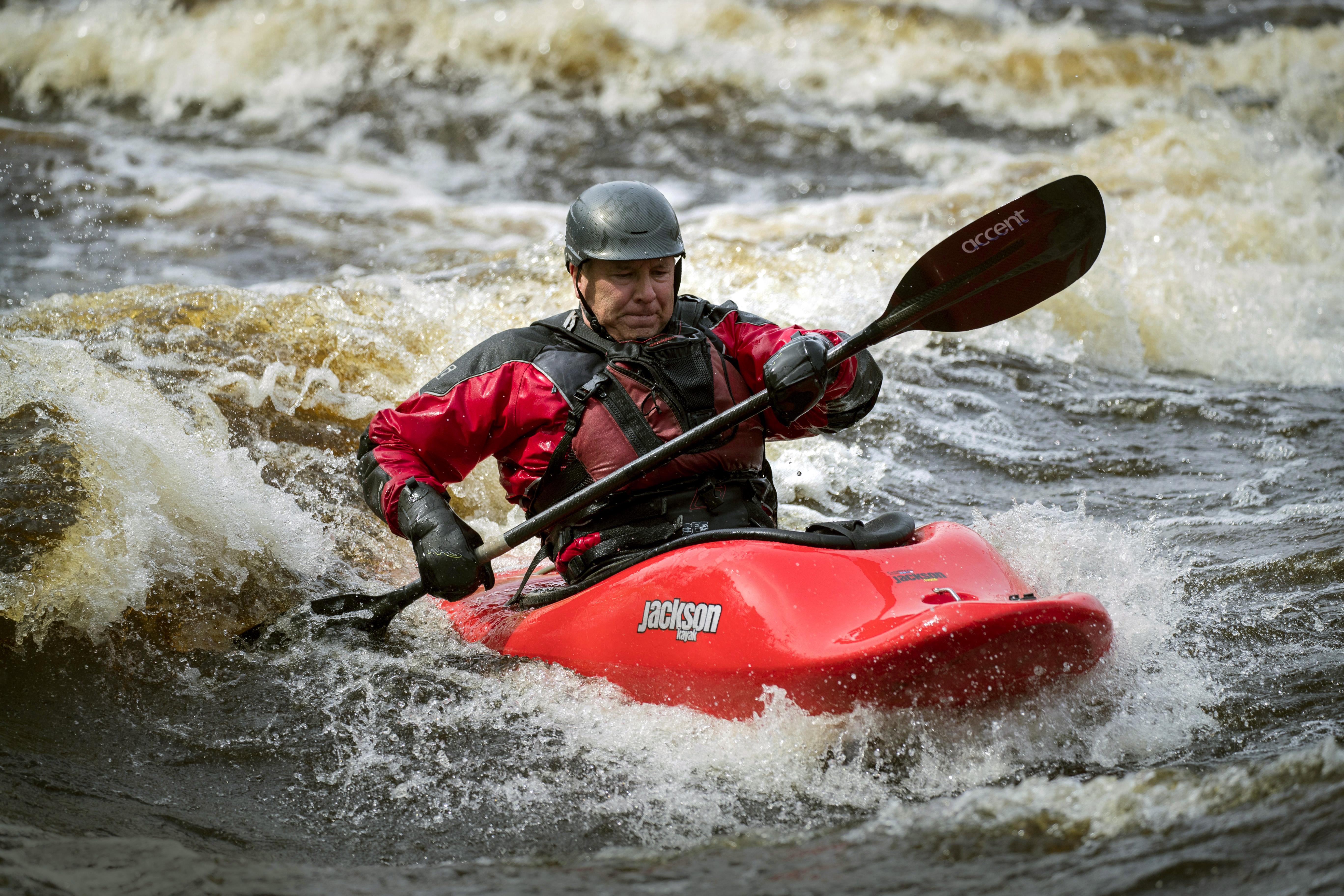 Jim Blake surfs the Blueberry Slide rapids on the Kettle River at Banning State Park.